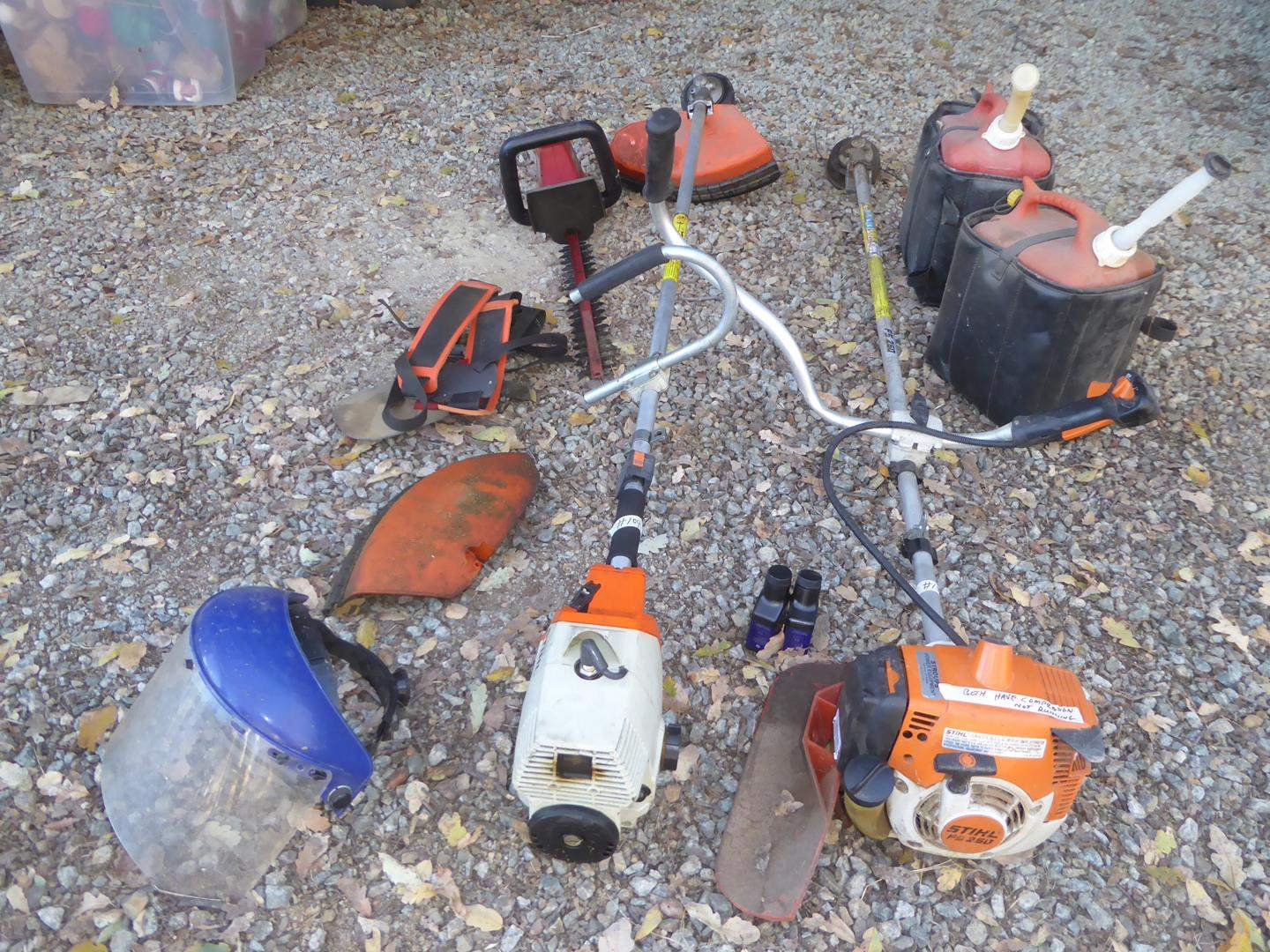 Lot # 104 - Two Weed Trimmers (Both Have Compression), Electric Hedge Trimmer (Works) & Gas Cans (main image)