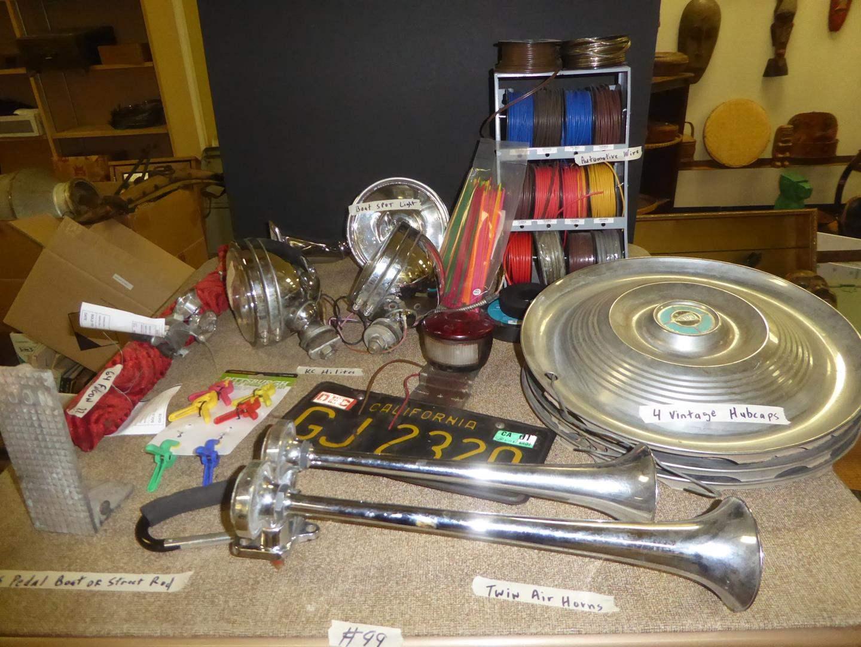 Lot # 99 - Twin Air Horns, Moon Gas Pedal, License Plate, 64 Falcon Door Handles, KC HiLites, Vtg Hubcaps & More (main image)