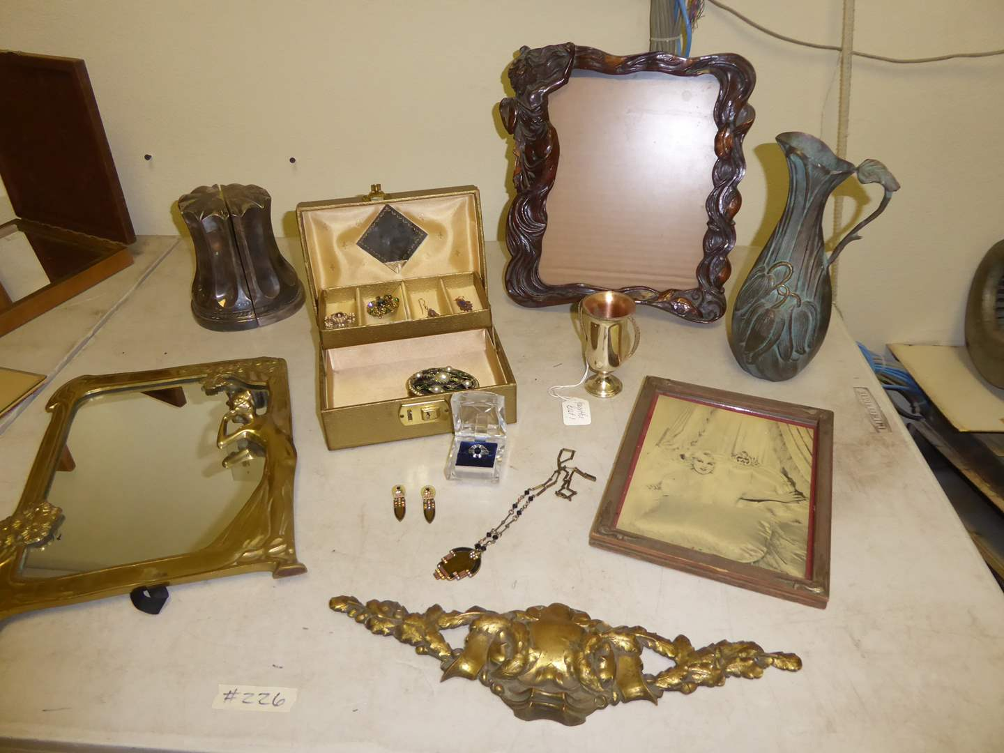 Lot # 226 - Art Deco Frames, Brass Pitcher, Jewelry & Plated Book Ends   (main image)