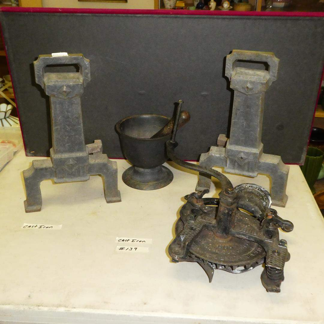 Lot # 139 - Antique Cast Iron Fireplace Andirons,  Mortar & Pestle and Hand Crank Corn Sheller  (main image)