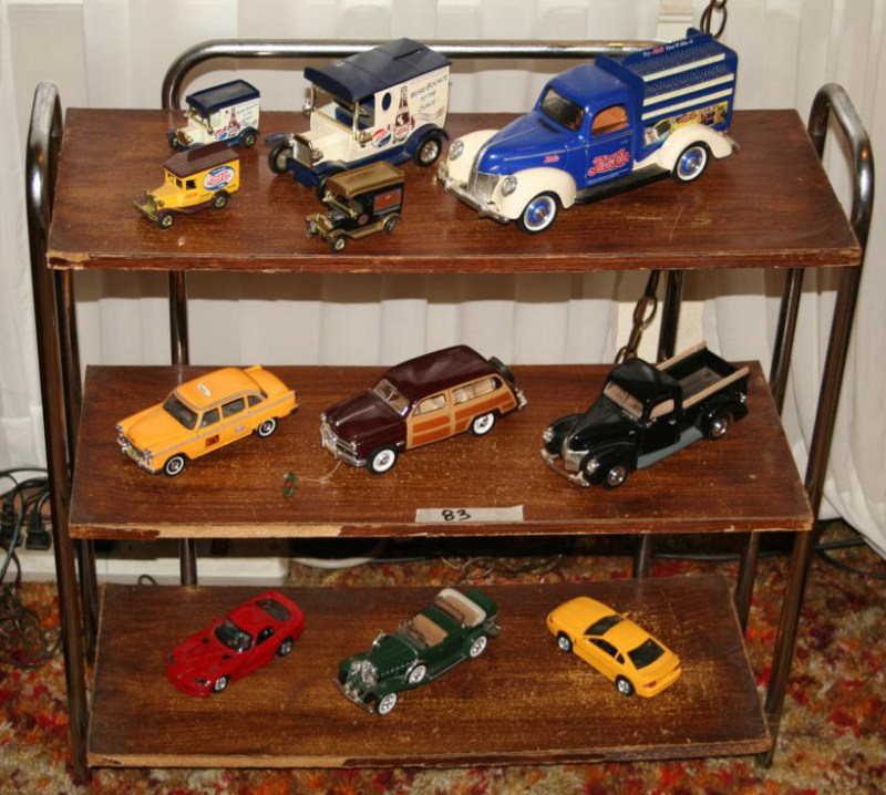 Lot #83 - Bookshelf with Contents: Diecast Cars, Trucks & Banks (main image)