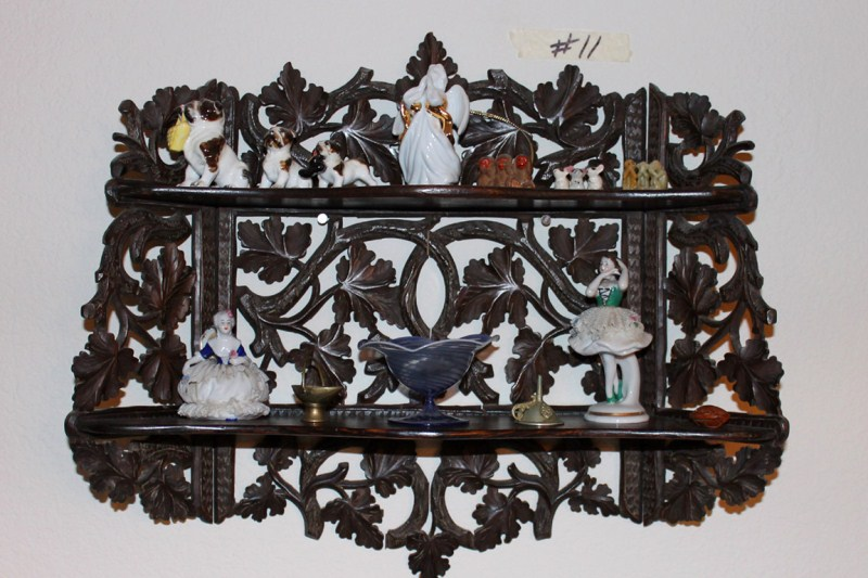 Lot #11 ~ Heavily Carved Black Forest Style Wooden Knick Knack Shelf & Contents (main image)