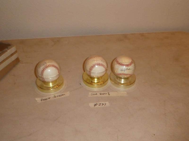 Lot # 241 - Three Signed Baseballs One Reggie Jackson, Dusty Baker  Other one Willie Mays? (main image)