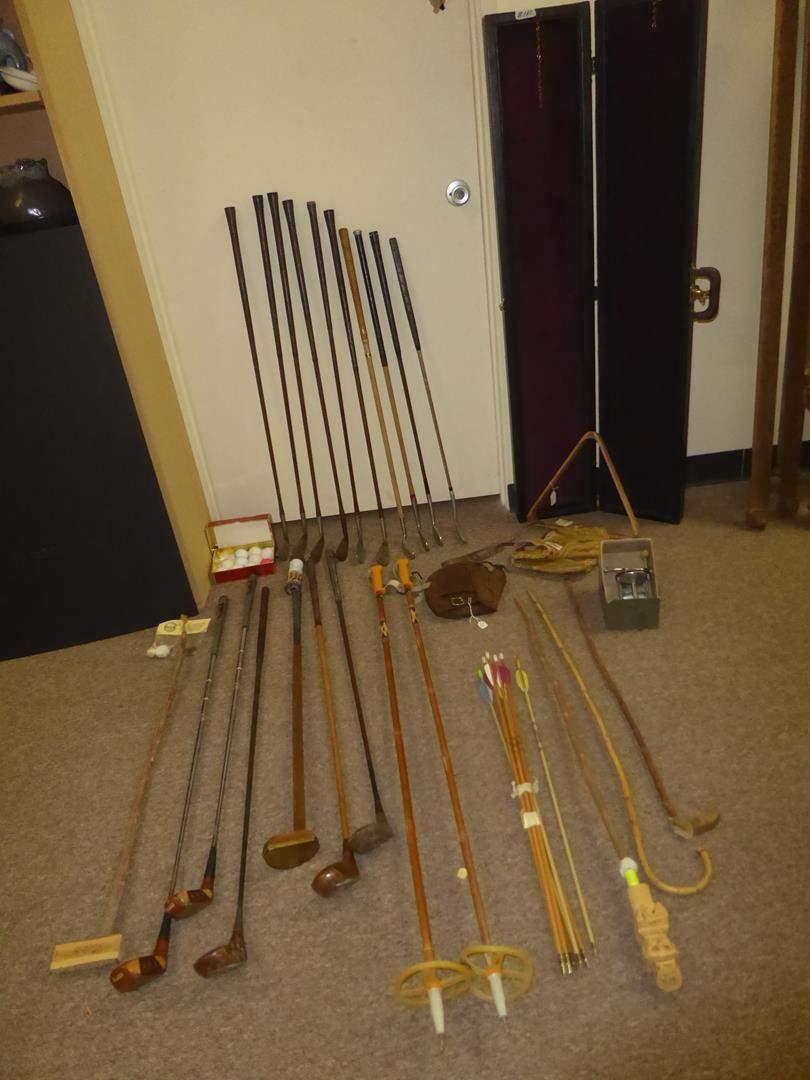 Lot # 160 - Golf Clubs, Golf Balls, Ski Poles & Fishing Reel (main image)