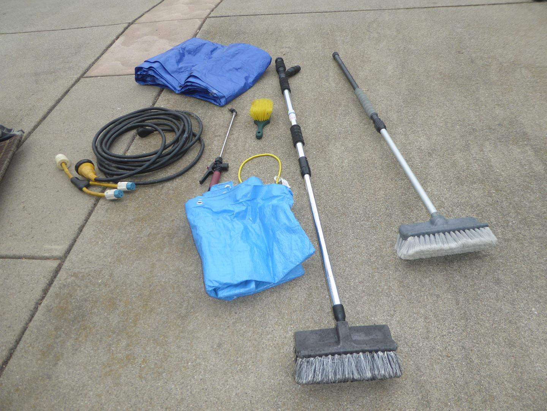 Lot # 86 - 220v Extension Cord, Tarps & RV Washing Brushes (main image)