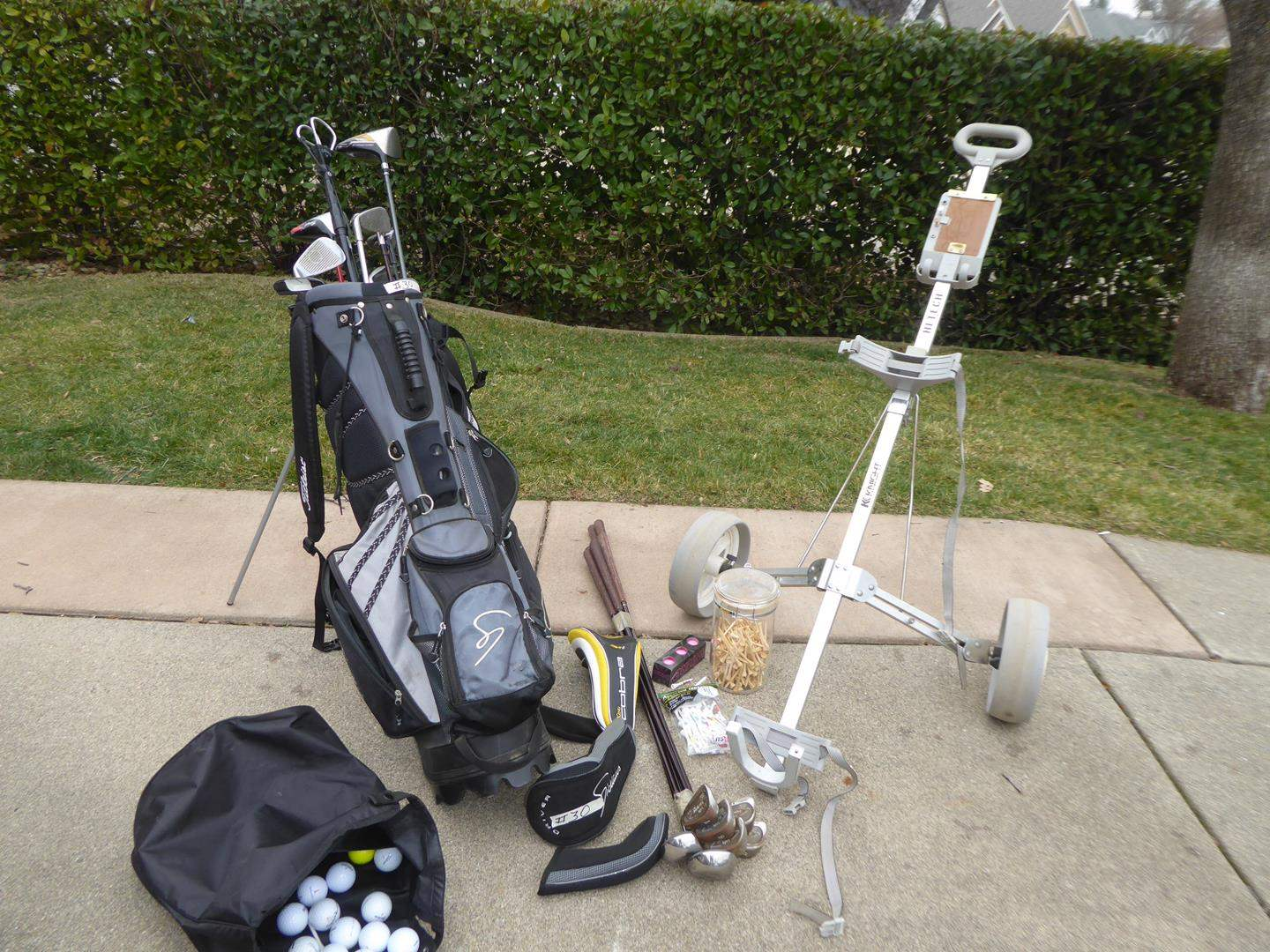 Lot # 30 - Jack Nicklaus Golf Bag and Knight Hi-Tech Cart w/ Misc. Golf Clubs, Balls and Tees  (main image)