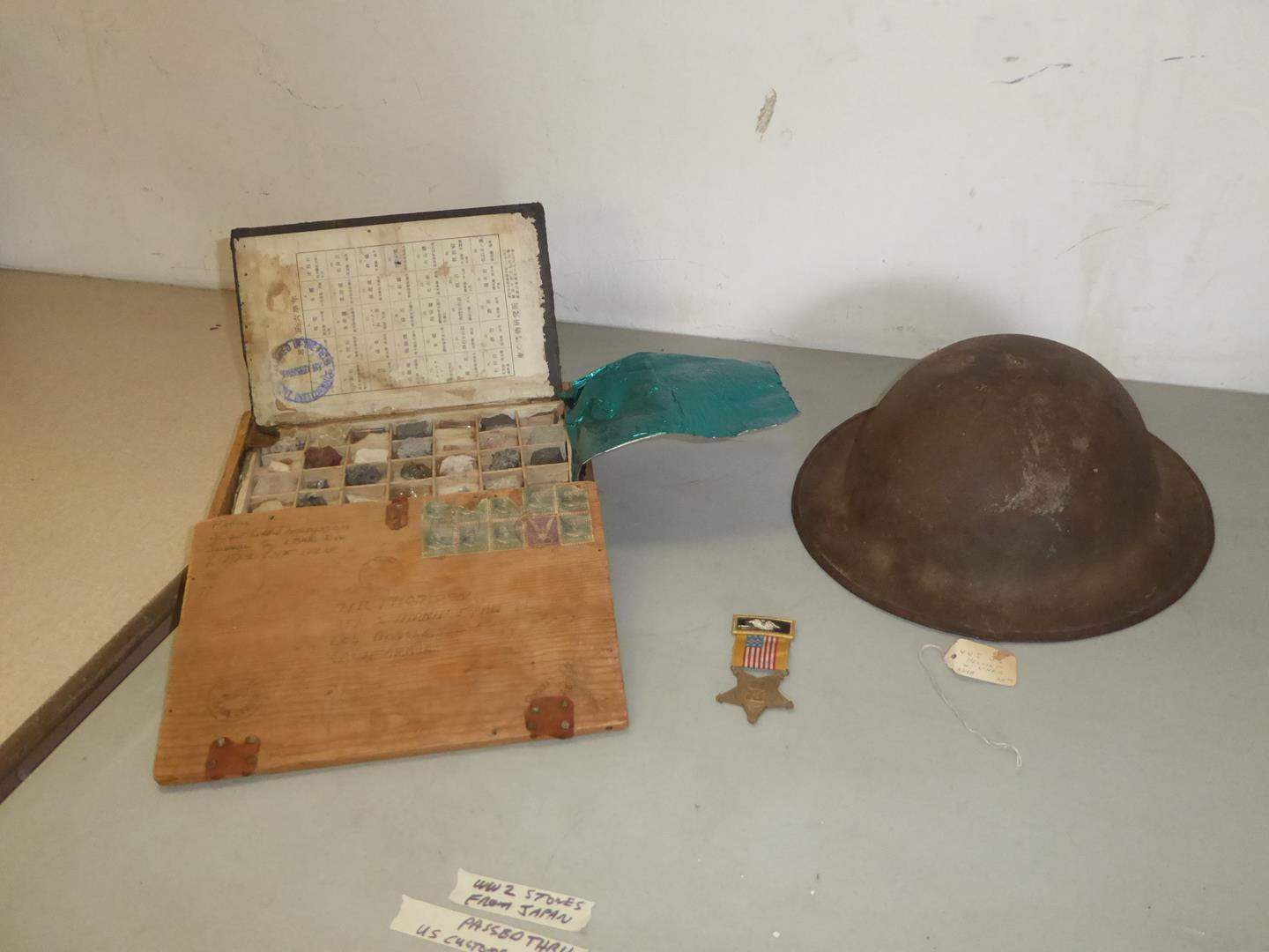 Lot # 242 - WWII Rocks From Japan Passed Through US Customs in 1945, WWI Helmet & Army Medal (main image)