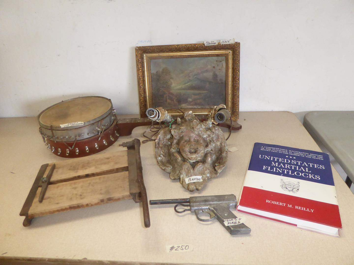 Lot # 250 - Antique Paper Cutter, Toy Gun, Old Distressed Plaster Cherub Wall Lamp, Banjo & Framed Oil on Canvas (main image)