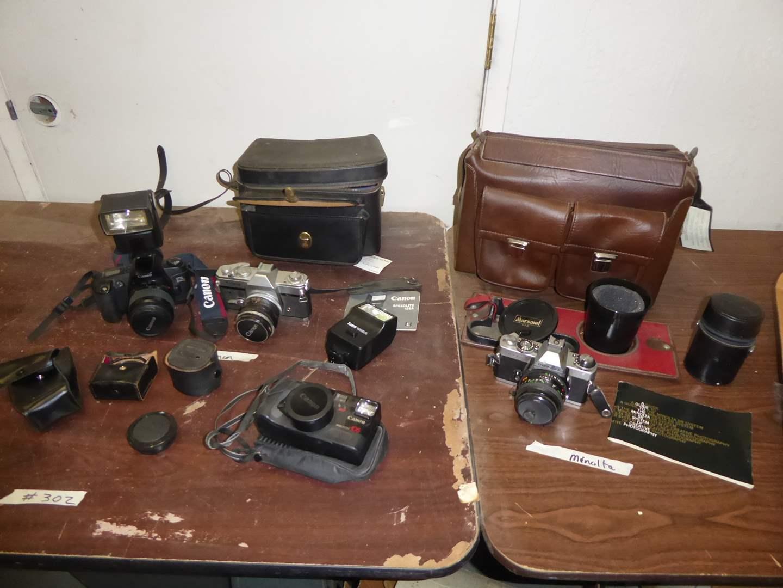 Lot # 302 - Cannon & Minolta Film Cameras  (main image)