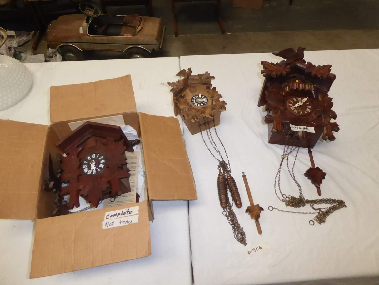Lot # 306 - Three Cuckoo Clocks (Not Tested) German Dancer Clock Needs Weights  (main image)