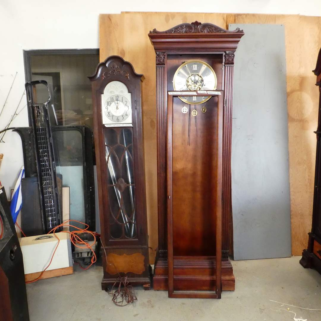 Lot # 140 -  Electric Howard Miller Grandfather Clock (Missing Parts/ Glass Door) & Electric Revere Grandfather Clock (Parts)  (main image)
