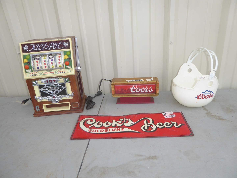 Lot # 172 - Vintage Jackpot Cassette Player, Coors Cash Register Sign, Painted Metal Cook's Beer Sign & Coors Helmet Bowl (main image)