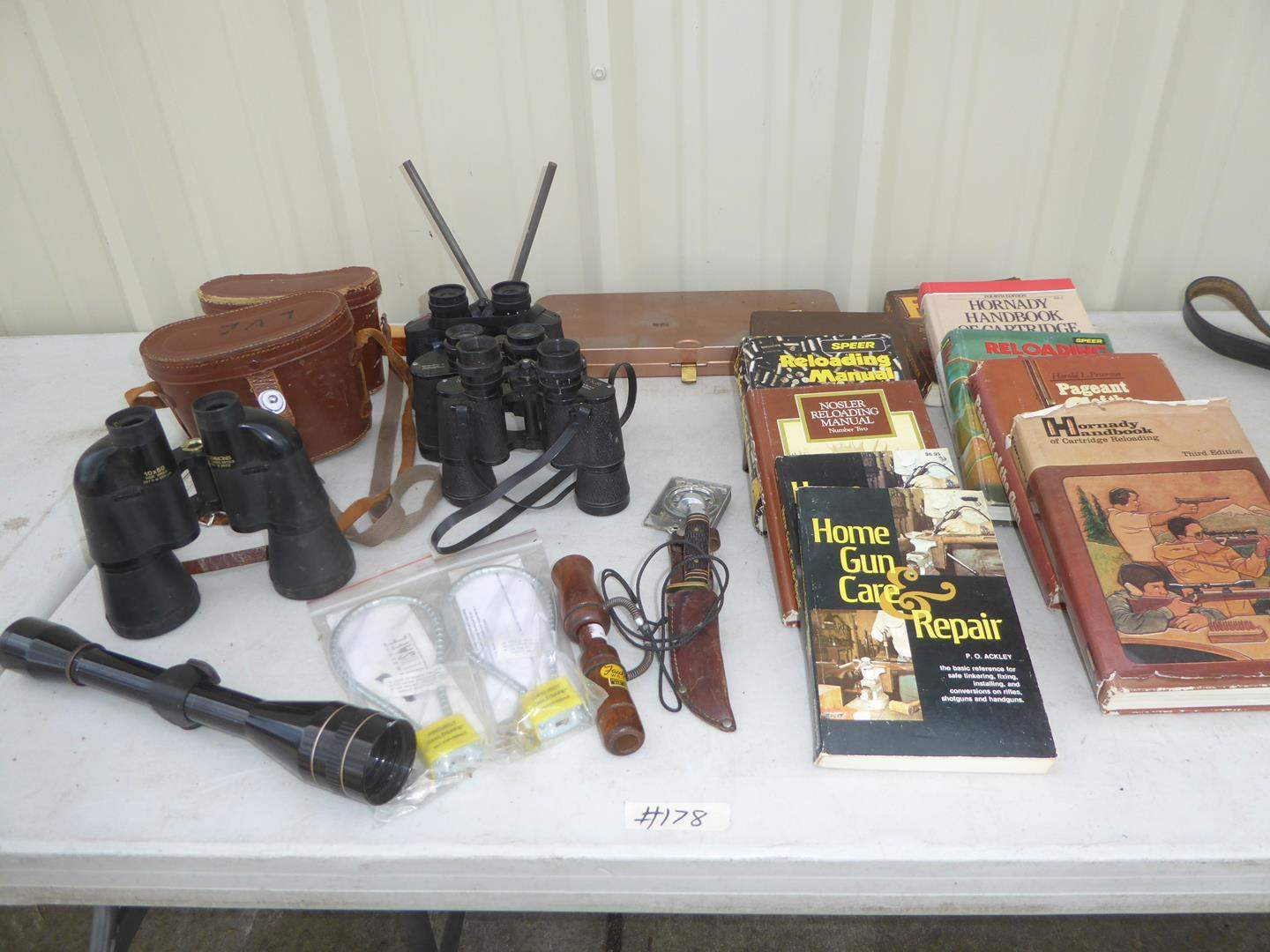 Lot # 178 - Leopold Scope, Binoculars, Duck Call, Buck Knife, Gun Cleaning Kit & Gun Books (main image)