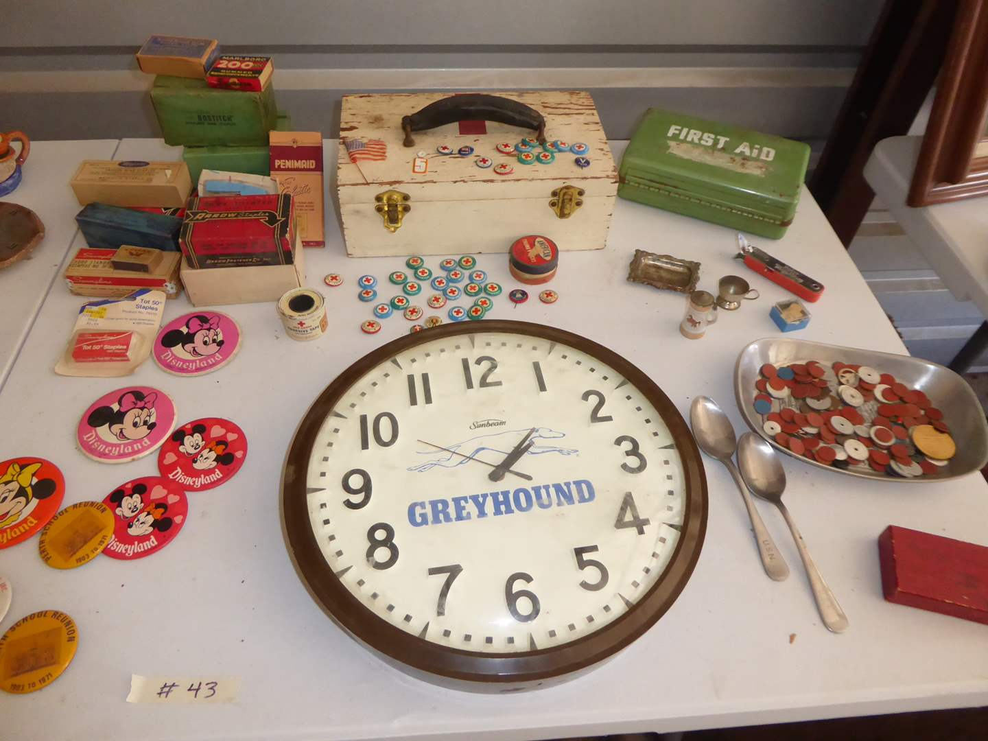 Lot # 43 - GreyHound Clock, Ration Tokens, Disneyland Pins & Swimmers Buttons  (main image)