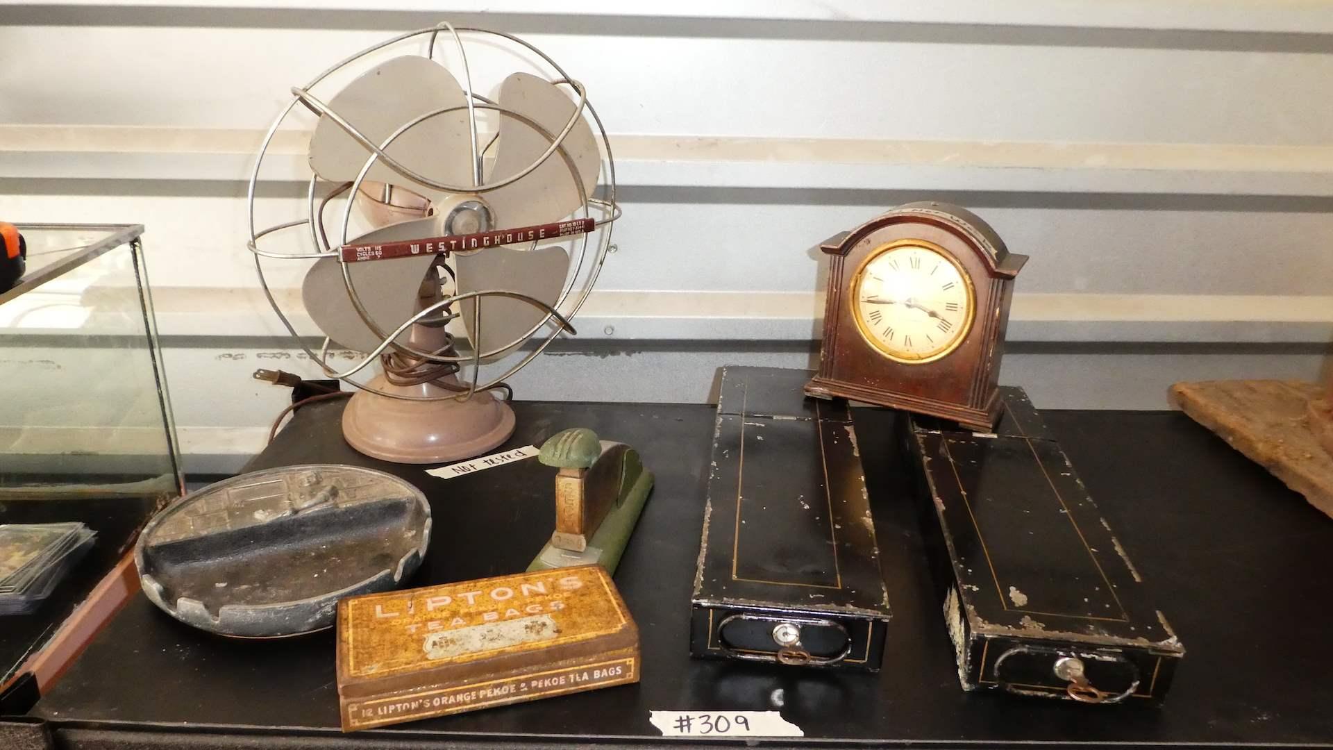 Lot # 309 - Vintage Collectors Lot(Vintage Metal Safety Deposit Boxes, Fan, Stapler, Clock & Metal Lipton Tea Box) (main image)