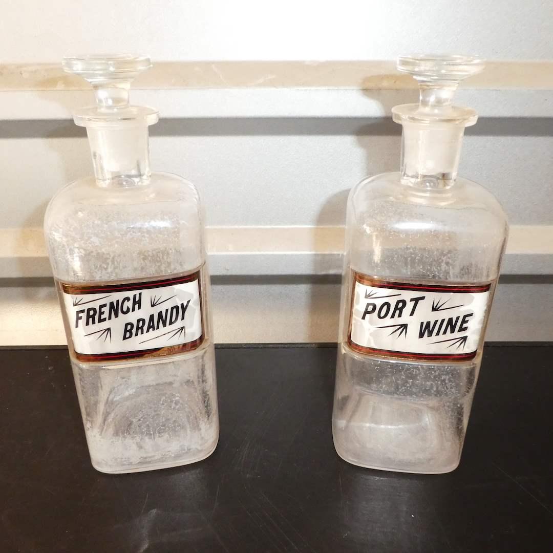 Lot # 324 - Vintage Label Under Glass Back-Bar Bottles (main image)