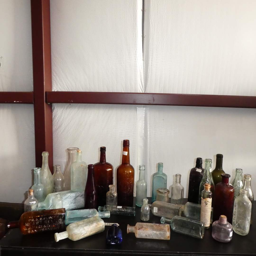 Lot # 336 - Assorted Vintage/ Antique Bottles (Embossed Glass) (main image)