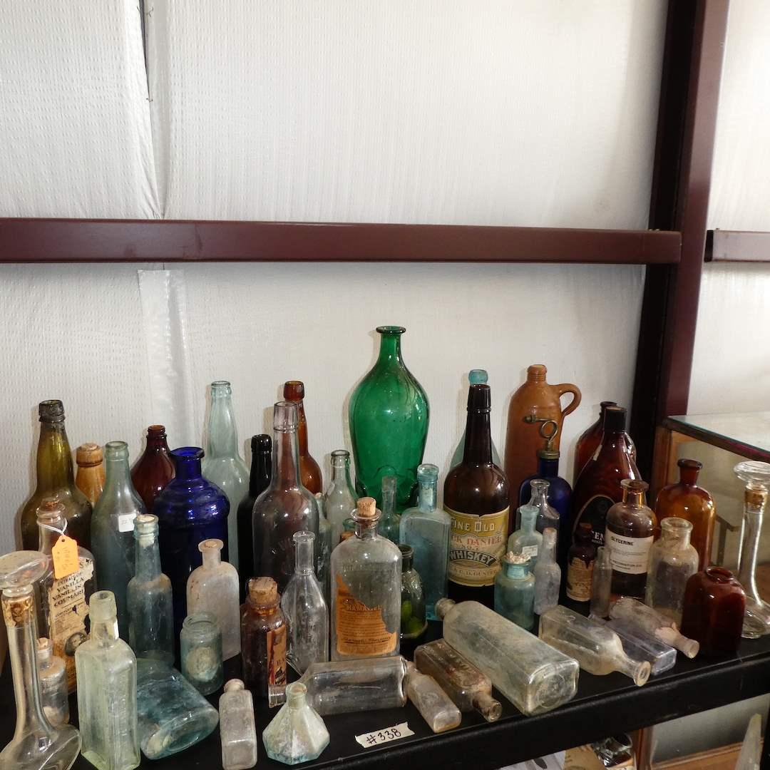 Lot # 338 -Assorted Vintage/ Antique Bottles (Embossed Glass) (main image)