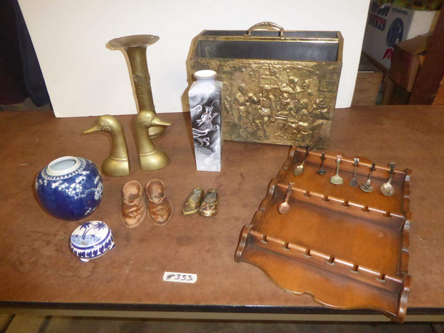 Lot # 333 - Vintage Mid Century Wooden Embossed Brass Magazine Rack, Brass Vase, Duck Bookends, Souvenir Spoons on Rack & More (main image)