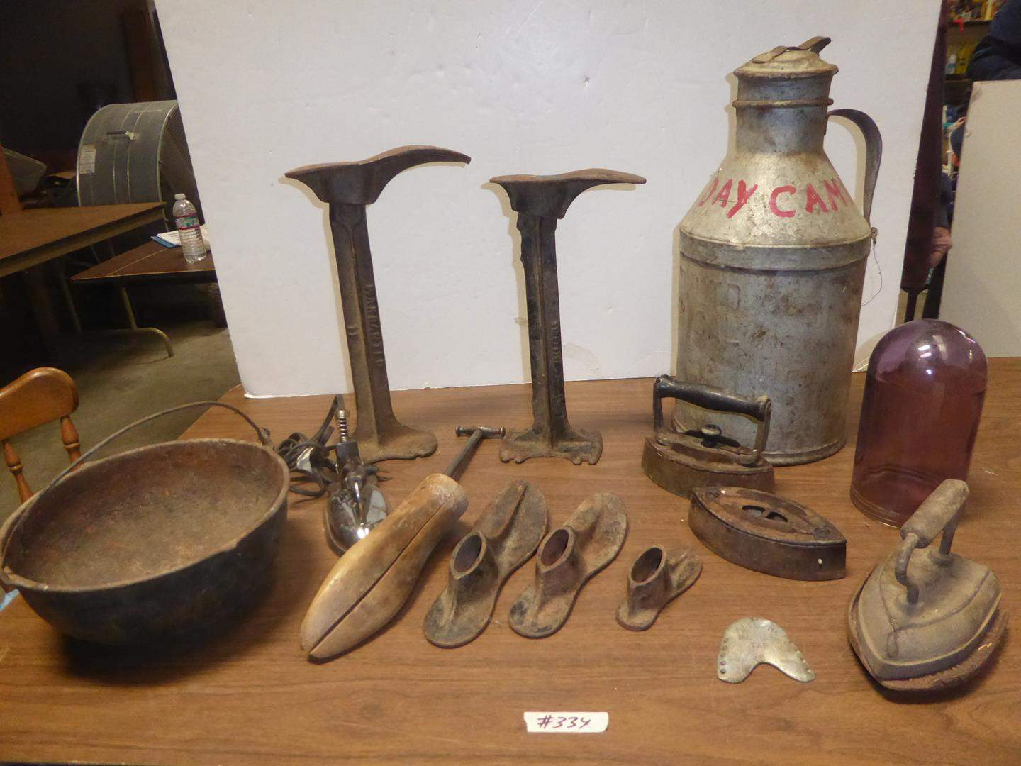 Lot # 334 - Vintage Cast Iron Kettle, Cobbler Shoes Forms, Dairy Can, Purple Globe & Sad Irons (main image)