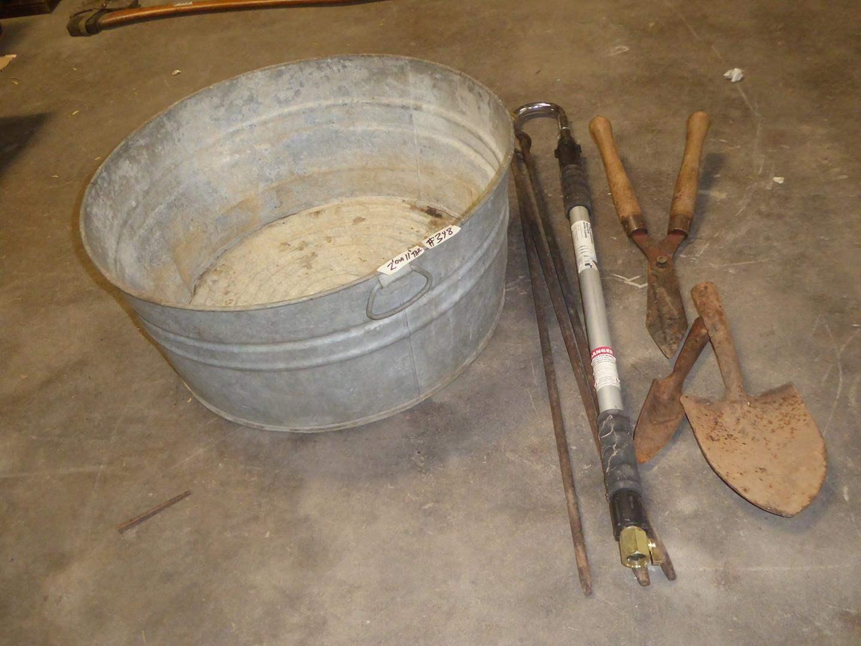 Lot # 348 - Round Metal Trough, Dutch Oven Tripod & Yard Tools (main image)