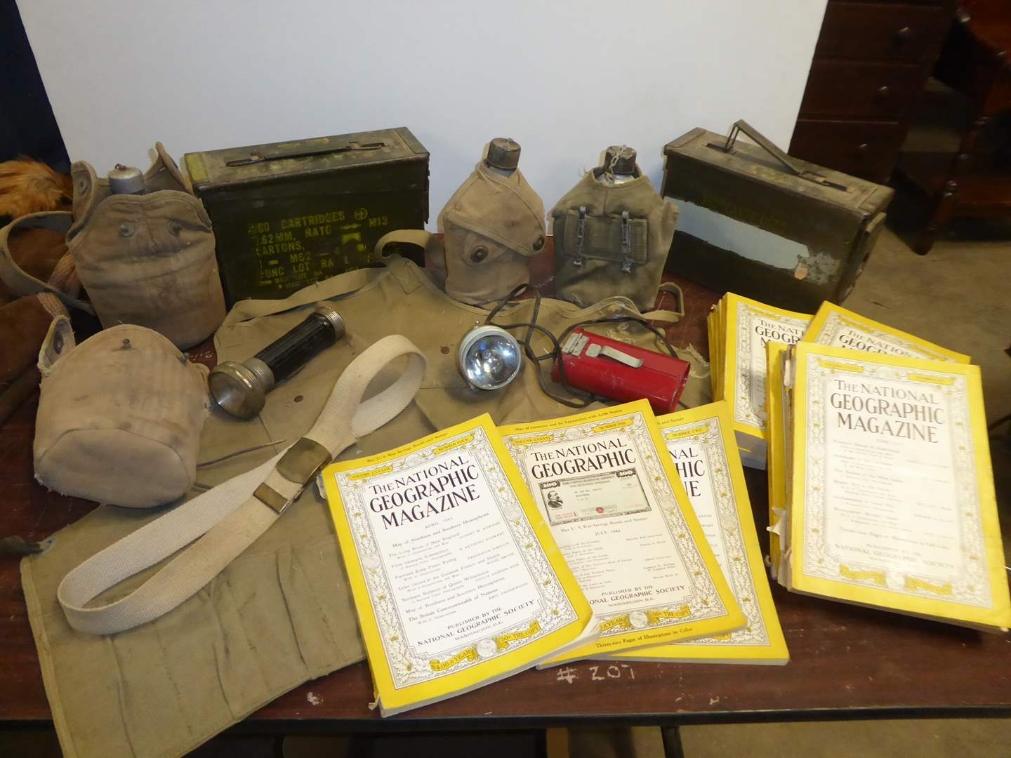 Lot # 251 - National Geographic's (30's, 40's 50's) & Military Gear  (main image)