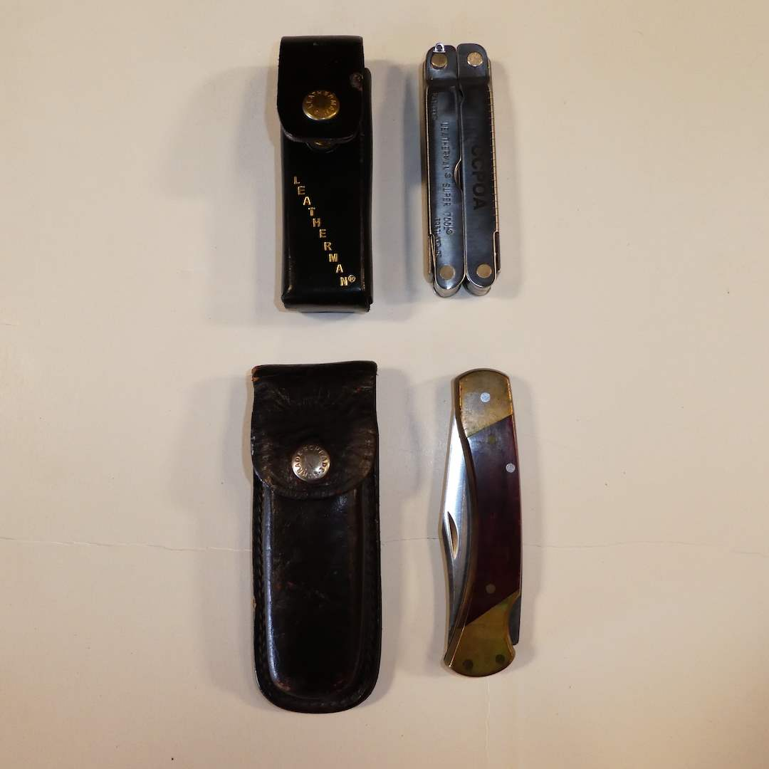 Lot # 38 - Uncle Henry Schrade LB7 and CCPOA Leatherman w/ Sheaths (main image)