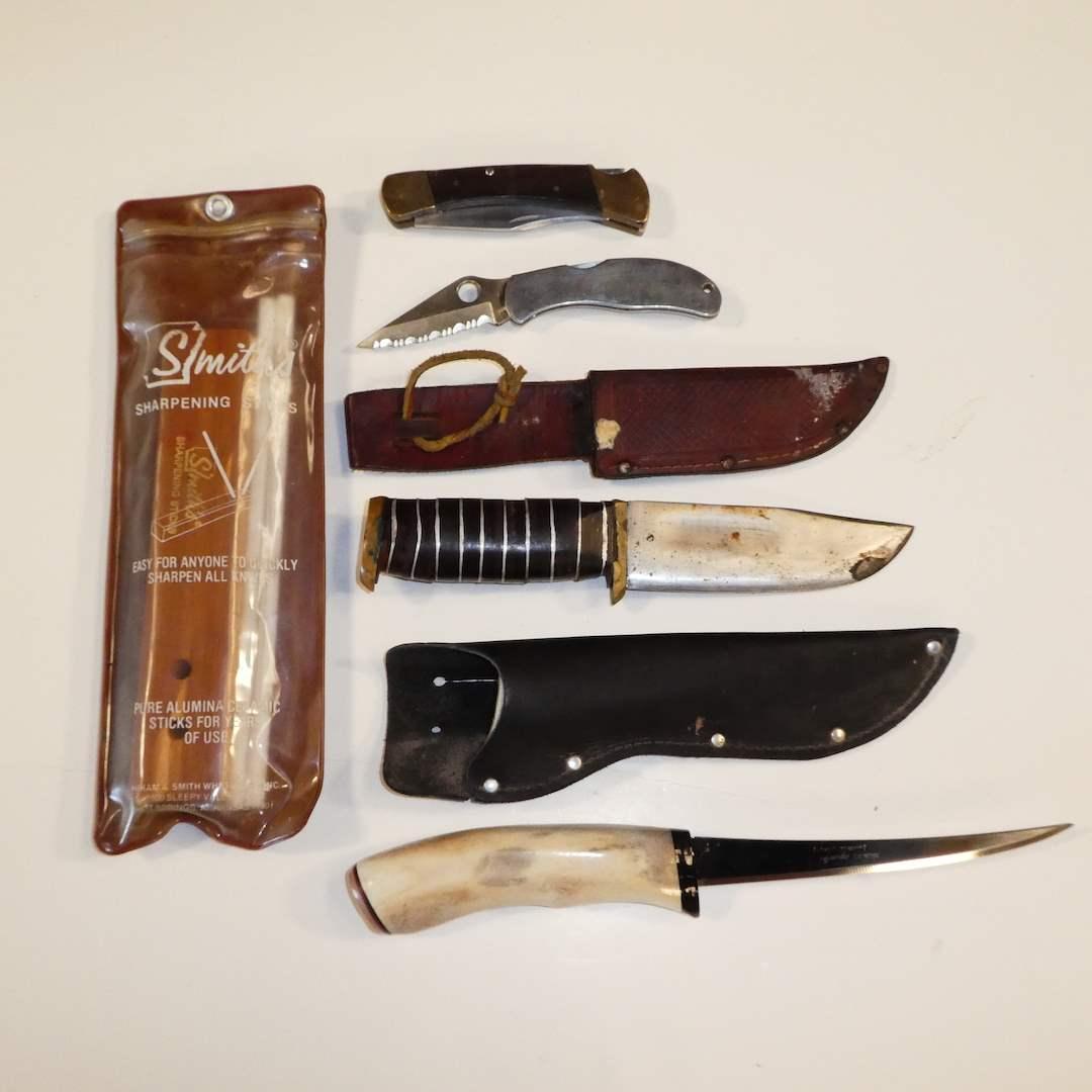 Lot # 55 - Normark Filet Knife, Spyderco & Buck 110 Folding Knives, Unmarked Knife and Sharpening Stix (main image)