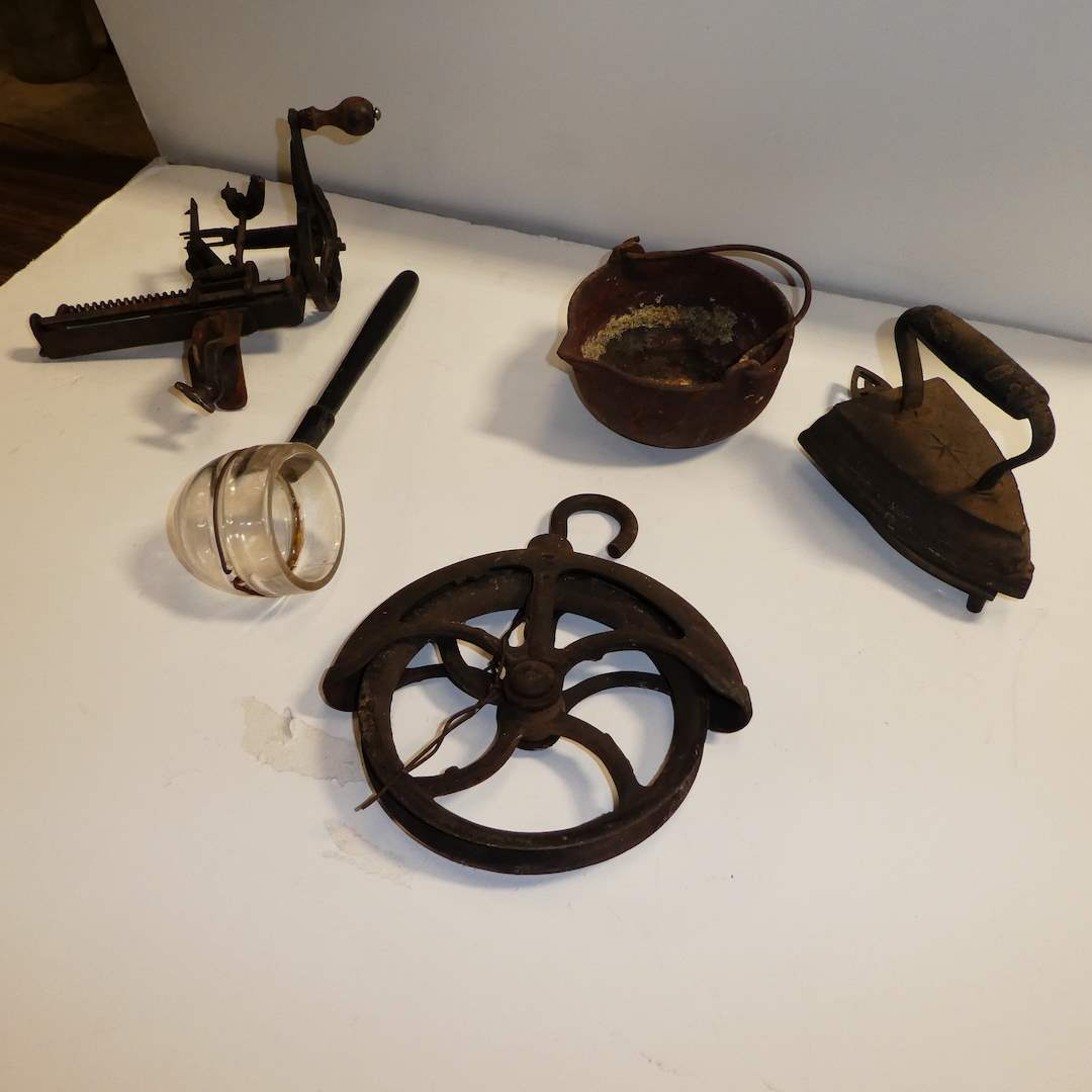 Lot # 277 - Vintage Cast Iron Lot ( Iron & Trivet, Wheel Pulley, Cooking Pot, Apple Corer and Glass Ladle w/ Wooden Handle) (main image)