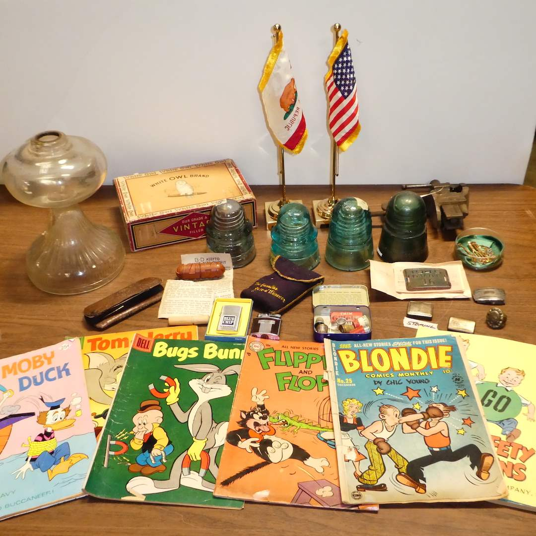 Lot # 279 - Vintage Variety Lot ( Glass Insulators, Seven Comic Books, Thimbles and More) (main image)