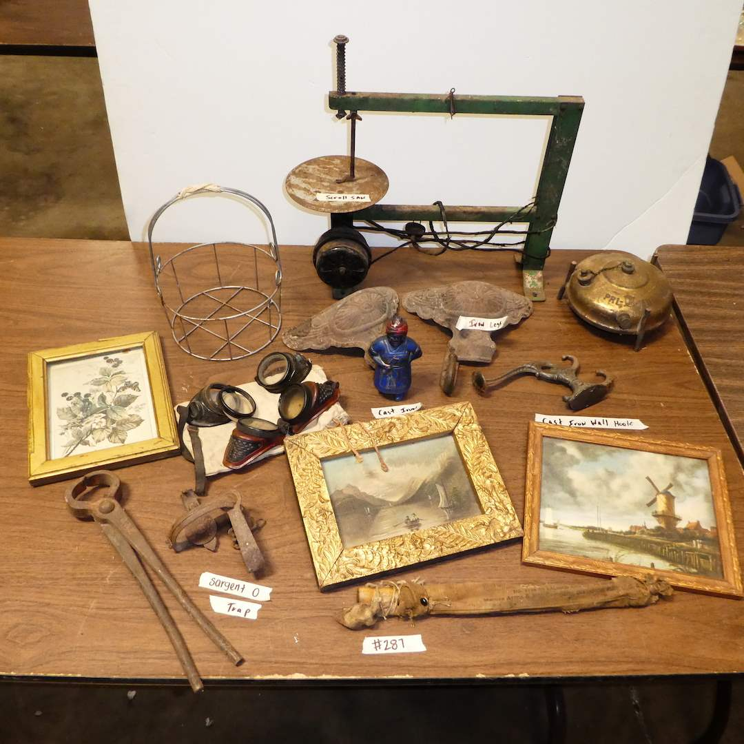 Lot # 287 - Vintage Cast Iron Sargent 0 Trap, Flight Goggles, Scroll Saw, Framed Art and Cast Iron (Figurine, Legs and Hooks) (main image)
