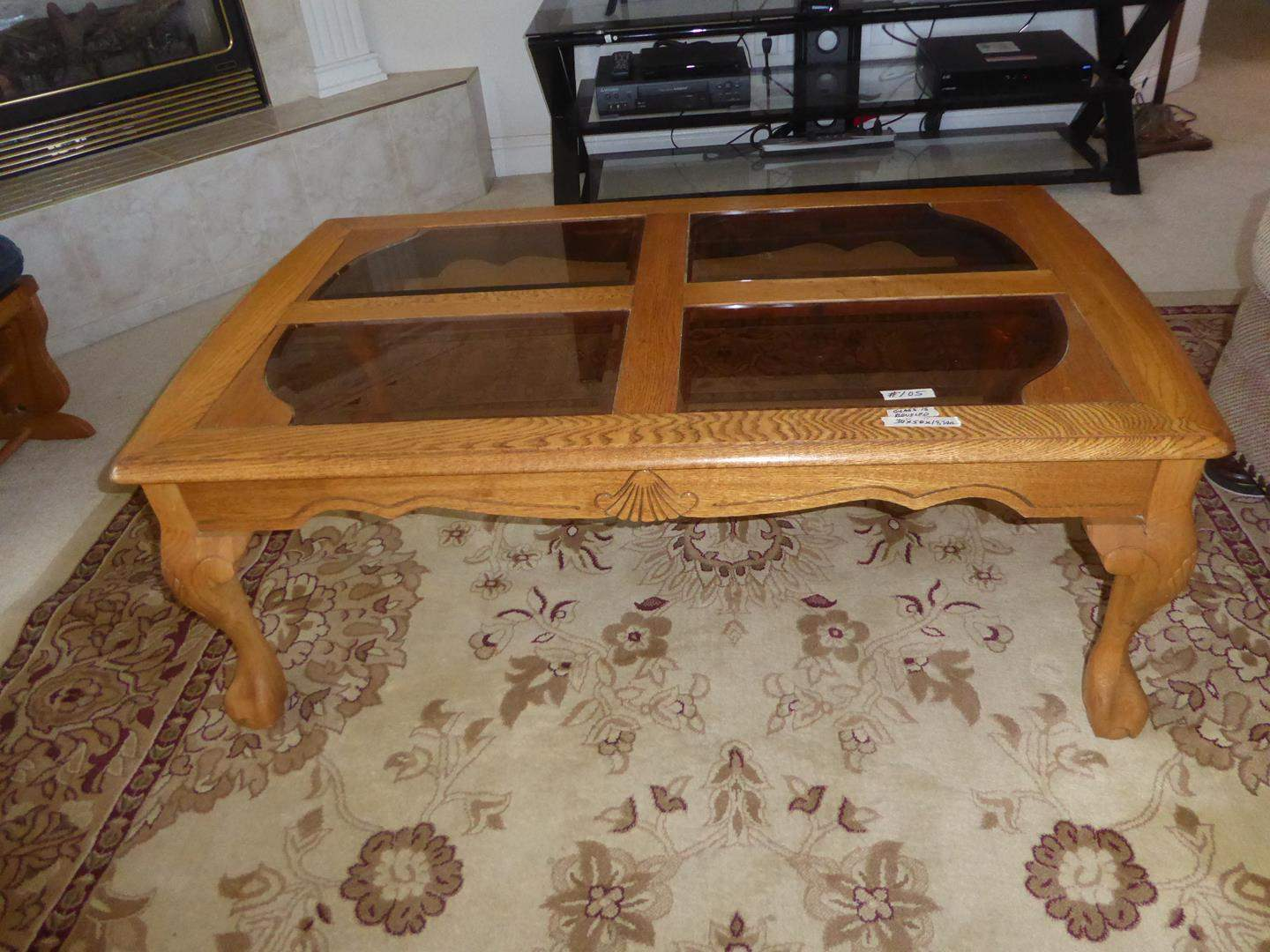 Lot # 105 - Claw Foot Four Paneled Beveled Glass Top Wooden Coffee Table (main image)