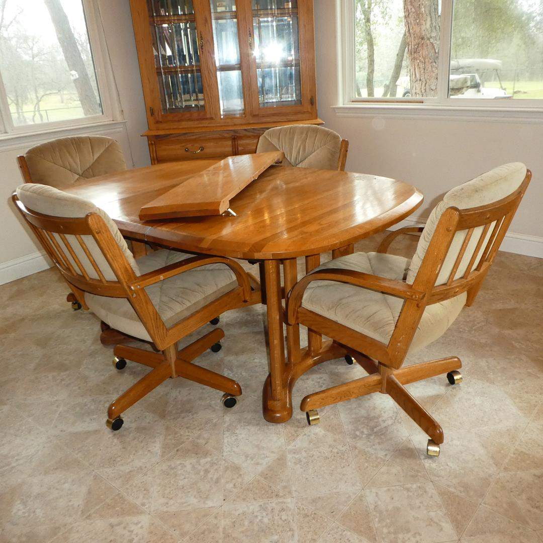 Lot # 182 - Vintage 'Walter of Wabash' Oak Dining Table w/Two Leaves & Four 'Douglas Furniture' Swivel Chairs on Wheels (main image)