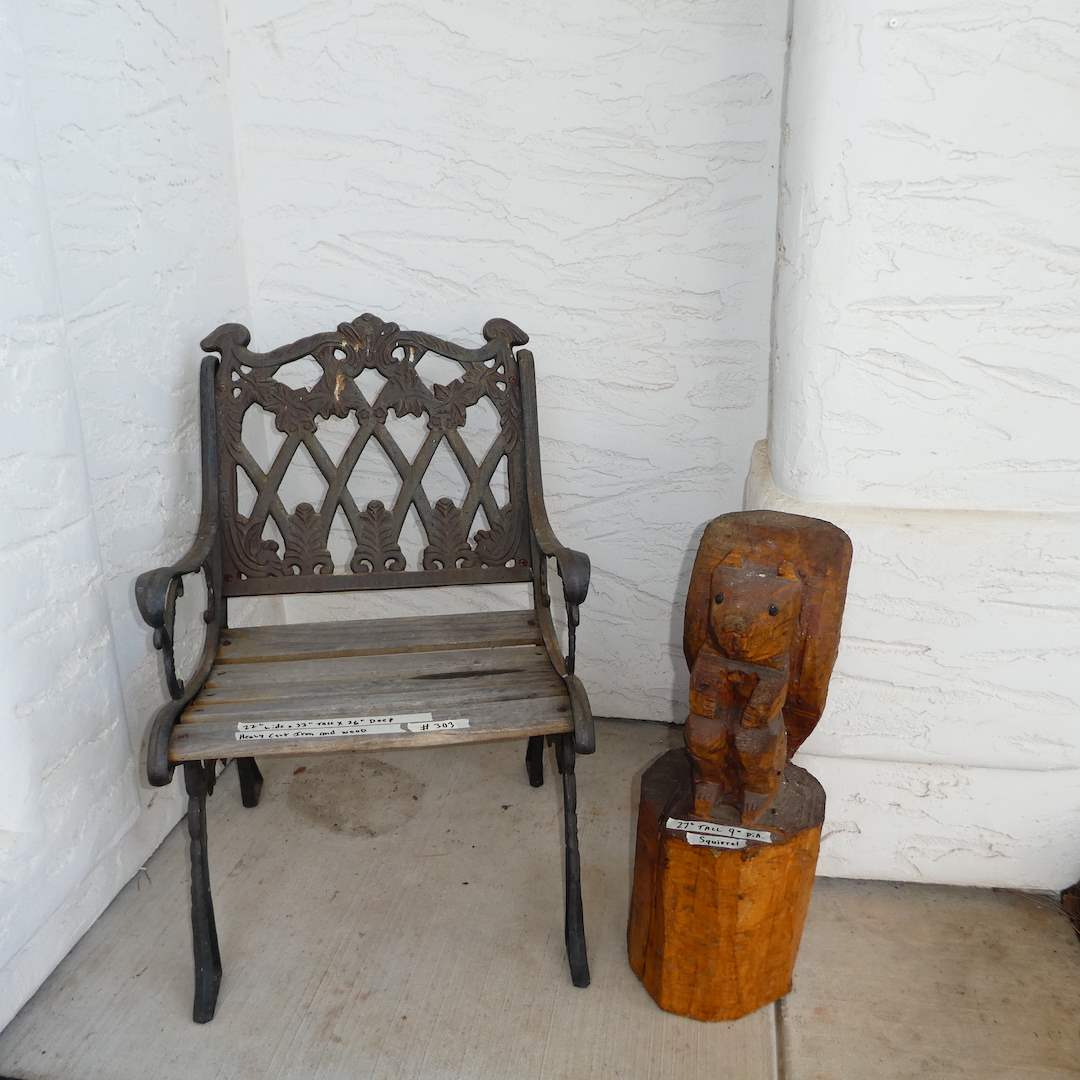 Lot # 303 - Heavy Cast Iron and Wood Single Bench and Hand Carved Wooden Squirrel  (main image)