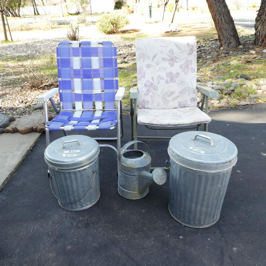 Lot # 323 - Two Folding Lawn Chairs, Small Galvanized Metal Trash Cans and Watering Can (main image)