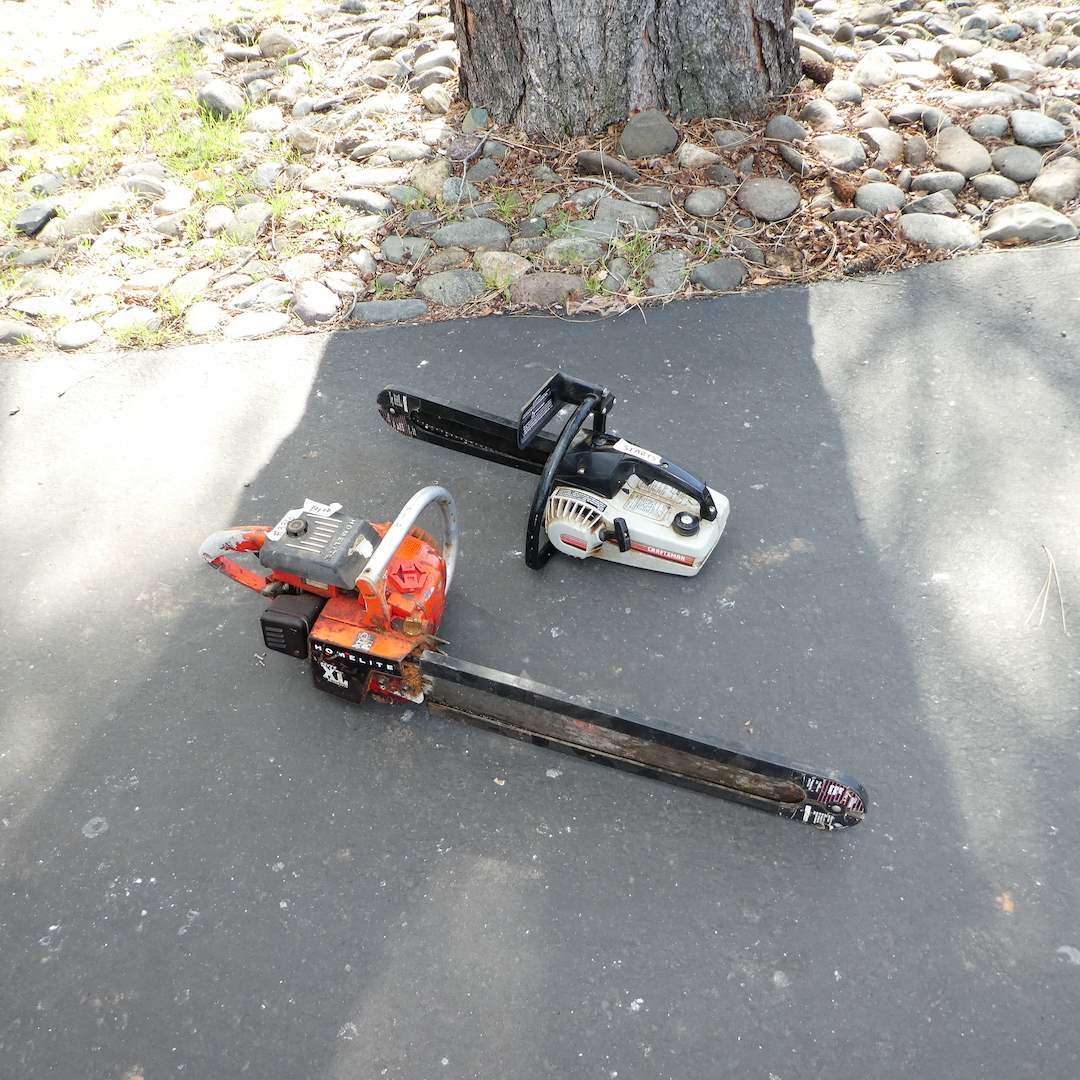 Lot # 336 - Two Chain Saws (Craftsman & Homelite) (Both Started up) (main image)