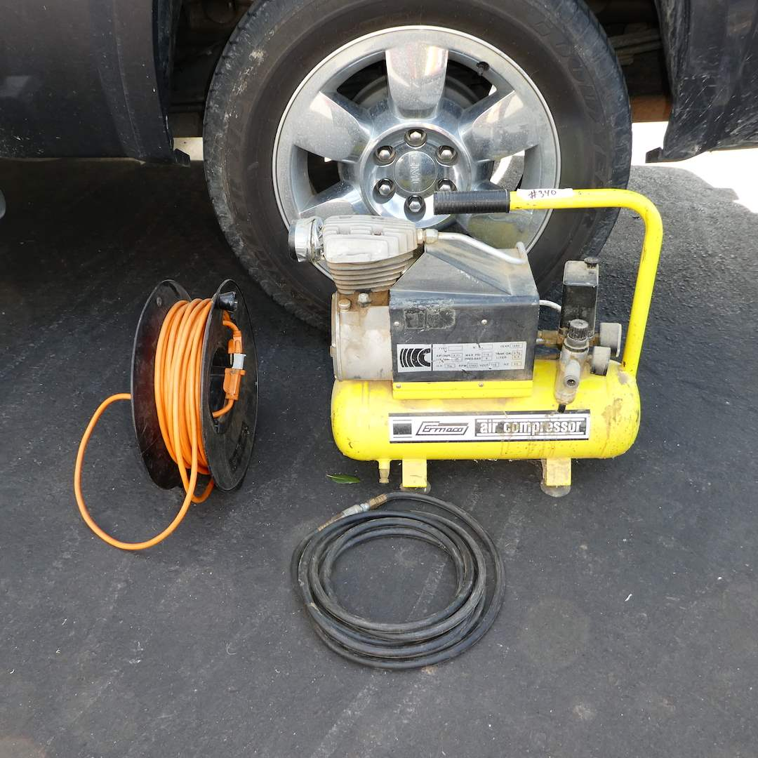 Lot # 340 - Ermaco Air Compressor and Extension Cord w/ Hand Reel (Works) (main image)