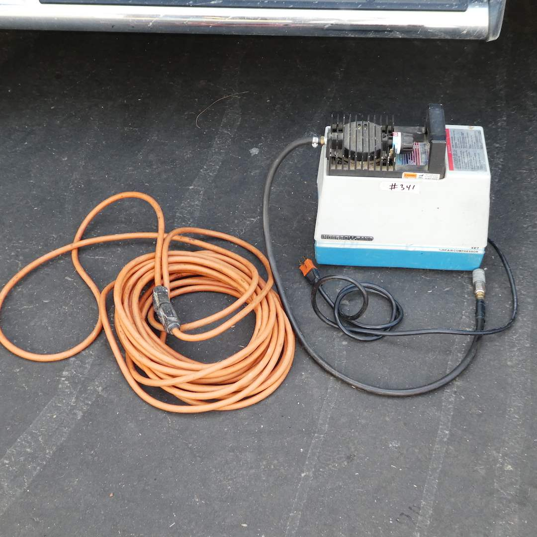 Lot # 341 - Small Ingersoll-Rand Air Compressor (Rand 4000) & Extension Cord (Works) (main image)