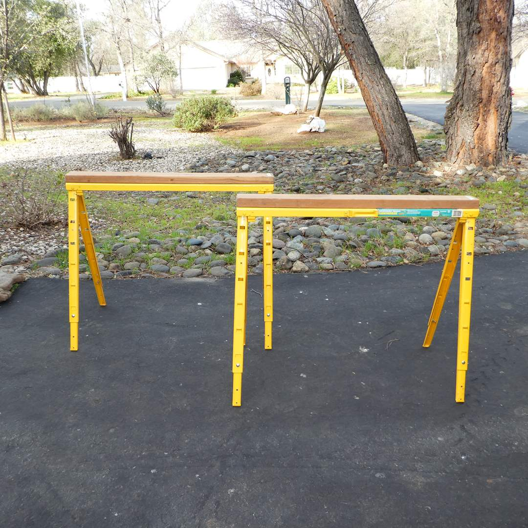 Lot # 343 - Two Pro Adjustable Sawhorses and Large Piece of Plywood (main image)