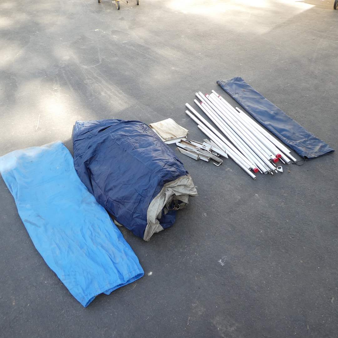 Lot # 370 - Large Eureka Tent, Poles and Stakes (Tent Was Not Put Together) (main image)