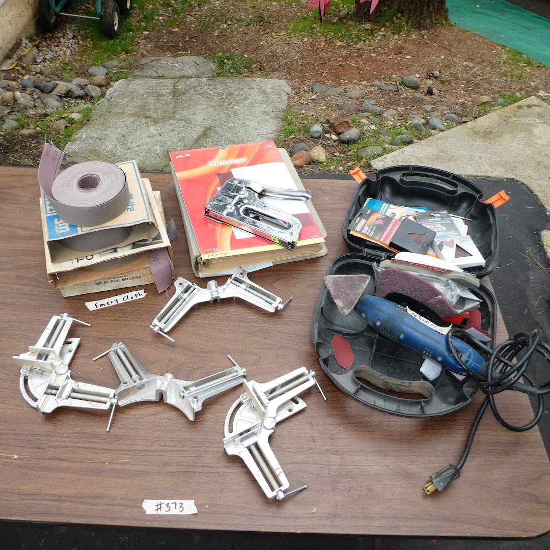 Lot # 373 - Ryobi Detail Sander, Framing Clamps, Emery Cloth and Construction Drafting Binder (main image)