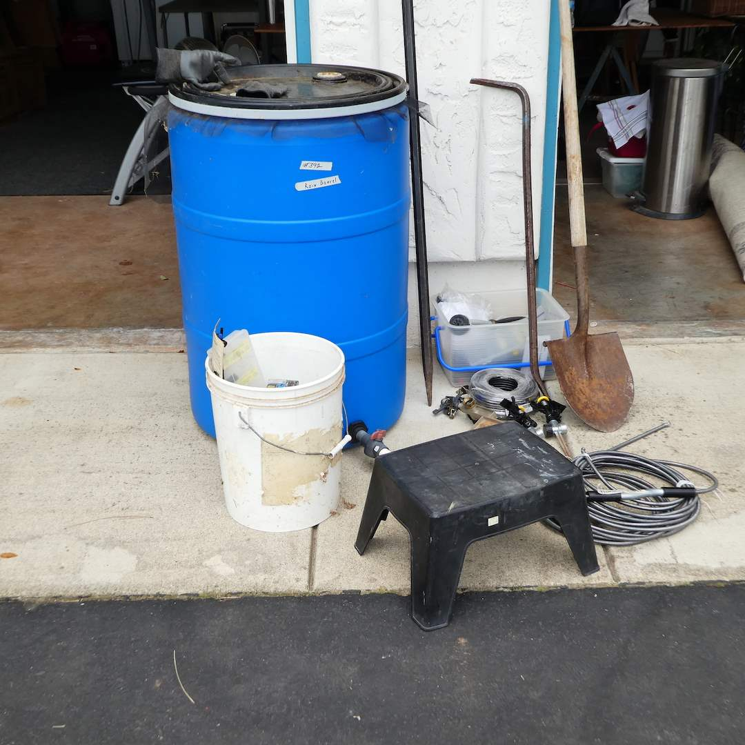 Lot # 392 - Rain Barrel, Plumbing Snake, Digging Bar, Shovel, and Sprinklers (main image)