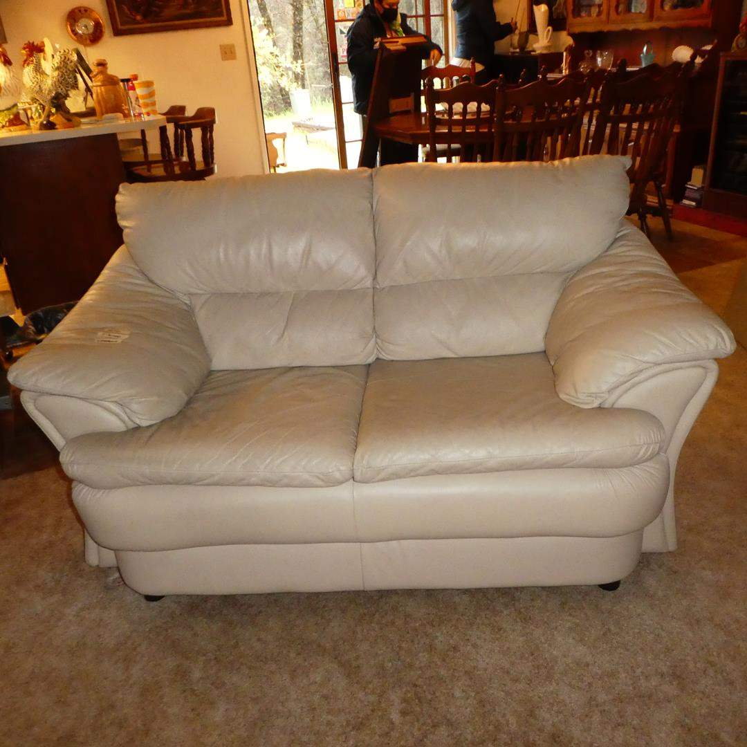 Lot # 104 - Quality Cream Colored Leather Loveseat - Good Condition (main image)