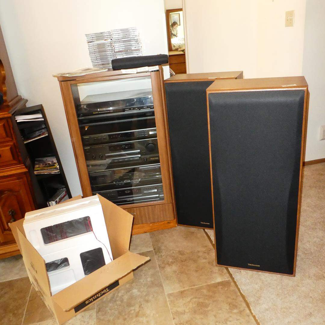 Lot # 124 - 'Technics' Electronic Components in Cabinet, Speakers, Surround Sound Speaker System & 50 Music Cds (main image)