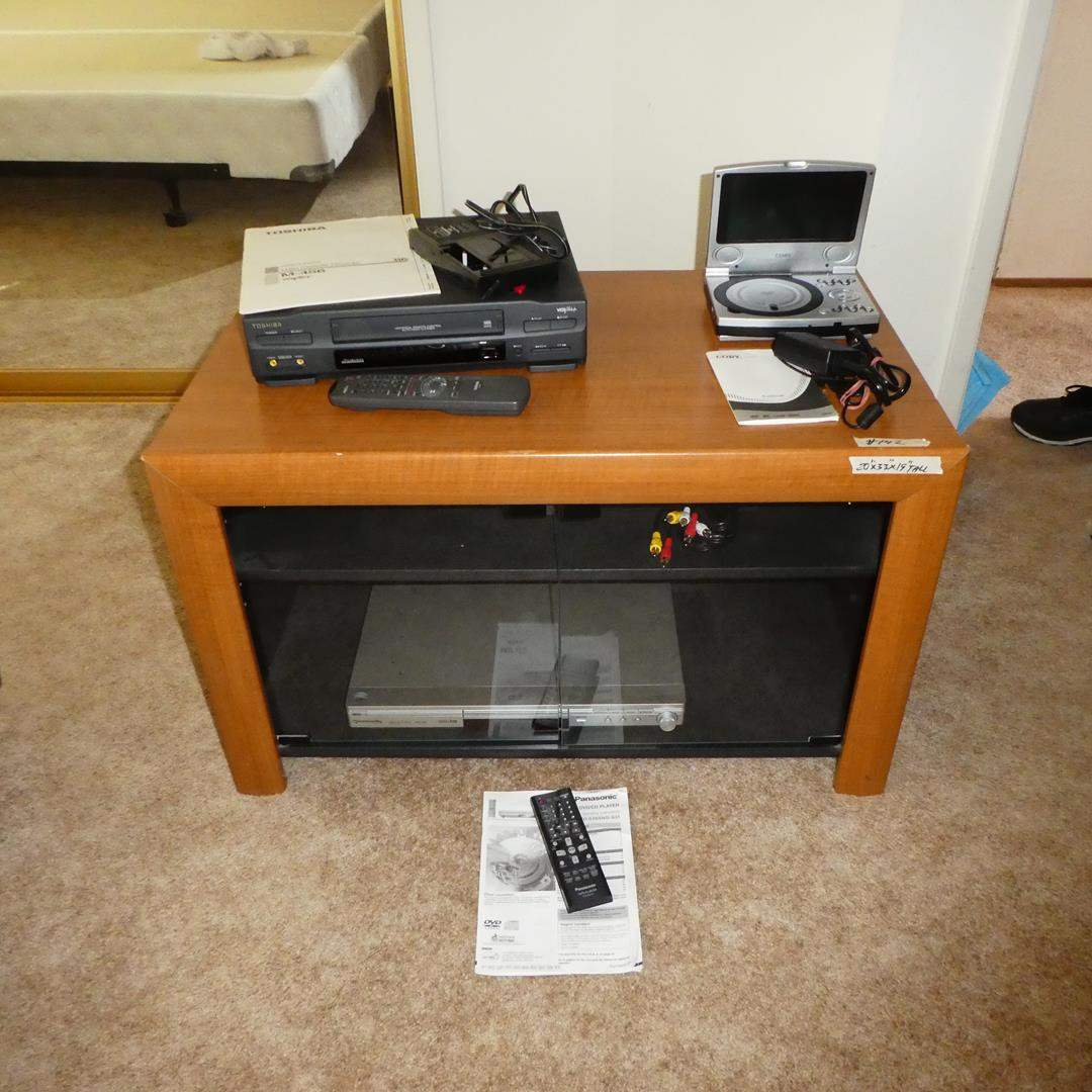 Lot # 142 - 'Toshiba' Video Cassette Recorder, 'Coby' DVD CD Player, Panasonic DVD Player & TV Stand (main image)