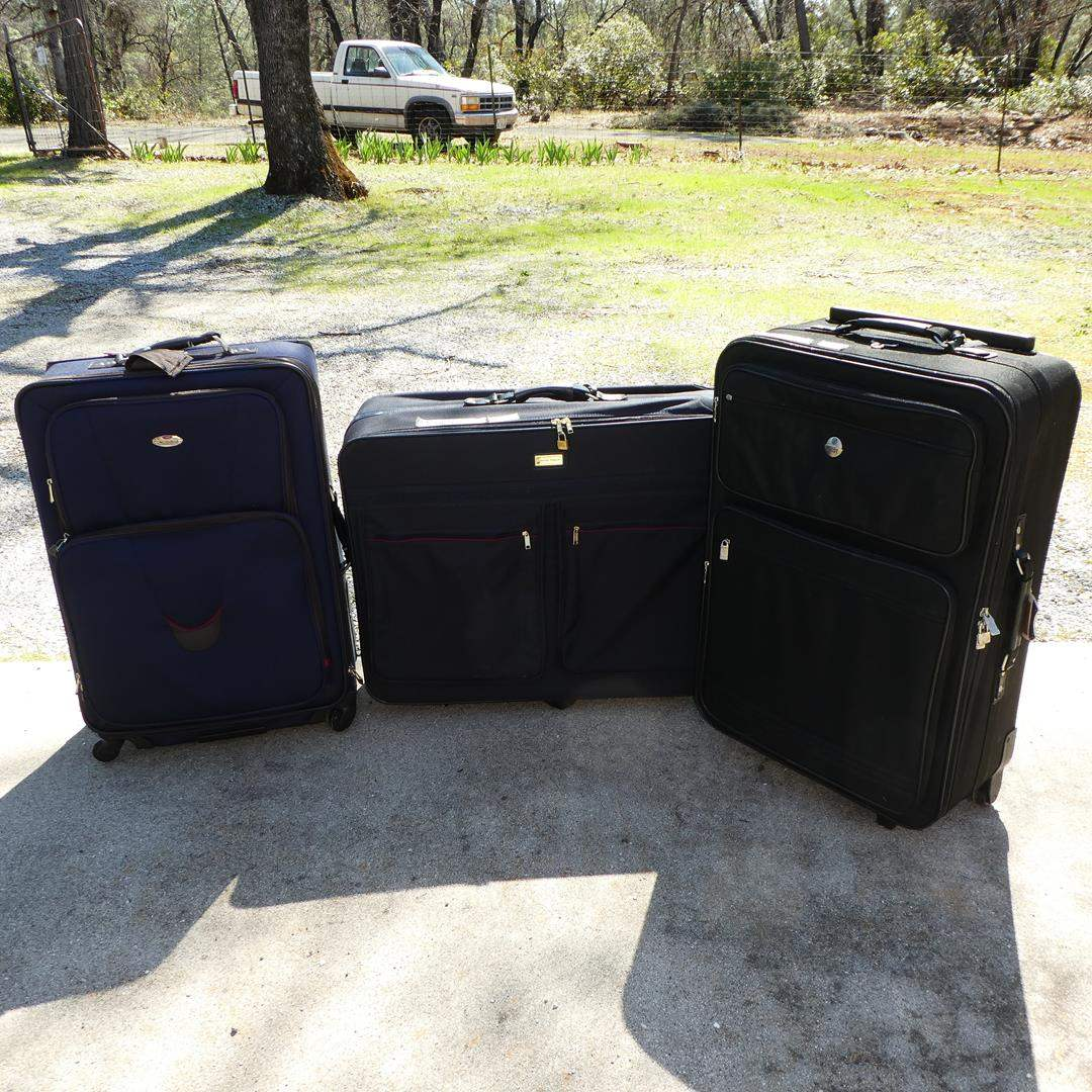 Lot # 304 - Three Luggage Cases on Wheels (main image)