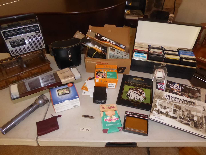 Lot # 74 - 8 Tracks, Crown Binoculars, Zire Palm One & Nuvi 200 Garmin  (main image)
