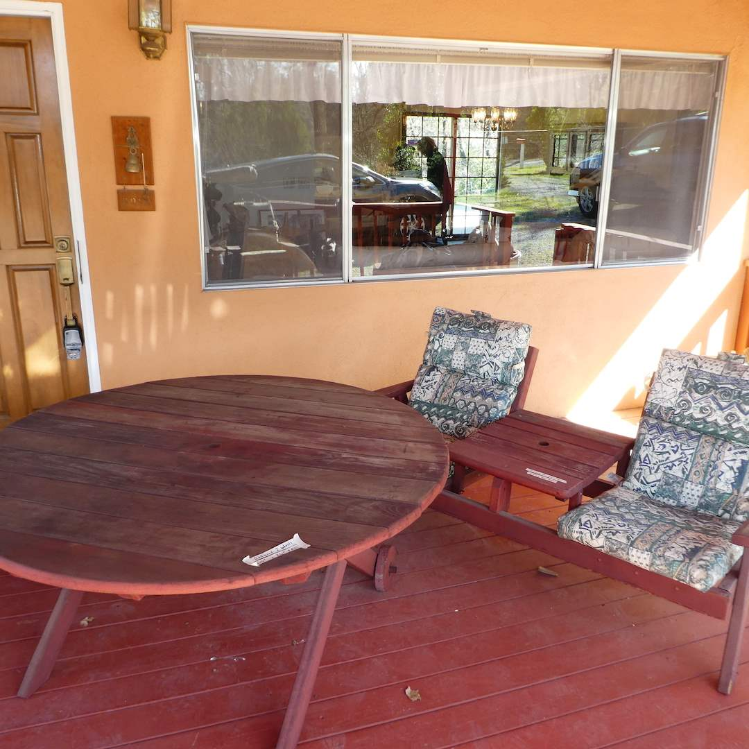 Lot # 239 - Outdoor Wooden Table w/ Wheels and Wooden Double Chair Bench w/ Table (main image)