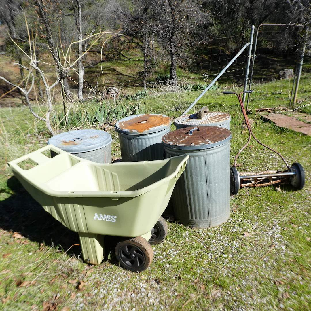 Lot # 241 - Ames Easy Roller Lawn Cart, Four Galvanized Trash Cans and Vintage Reel Push Lawn Mower (main image)