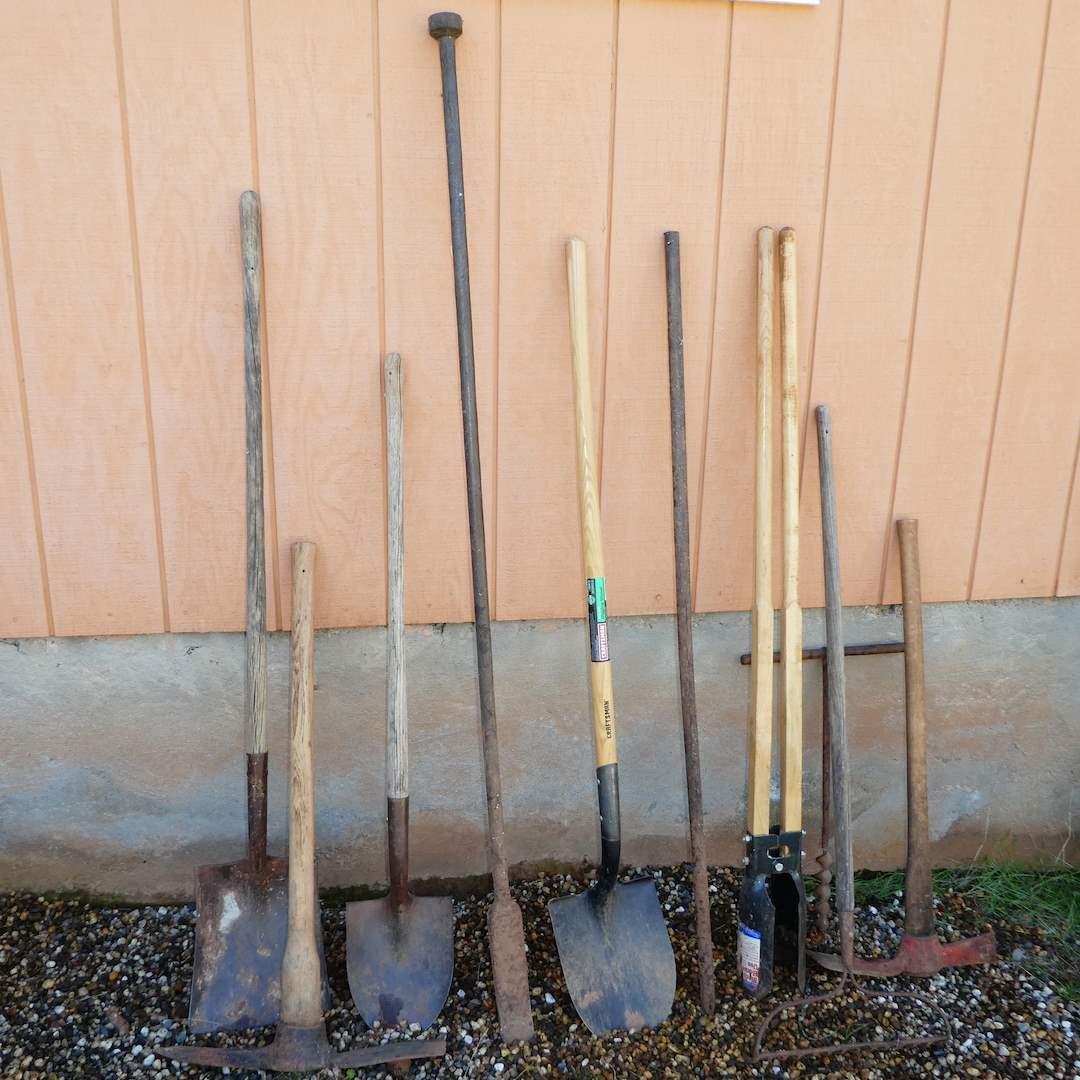 Lot # 243 - Post Hole Diggers, Digging Bars, Shovels, Pike Axes and More (main image)